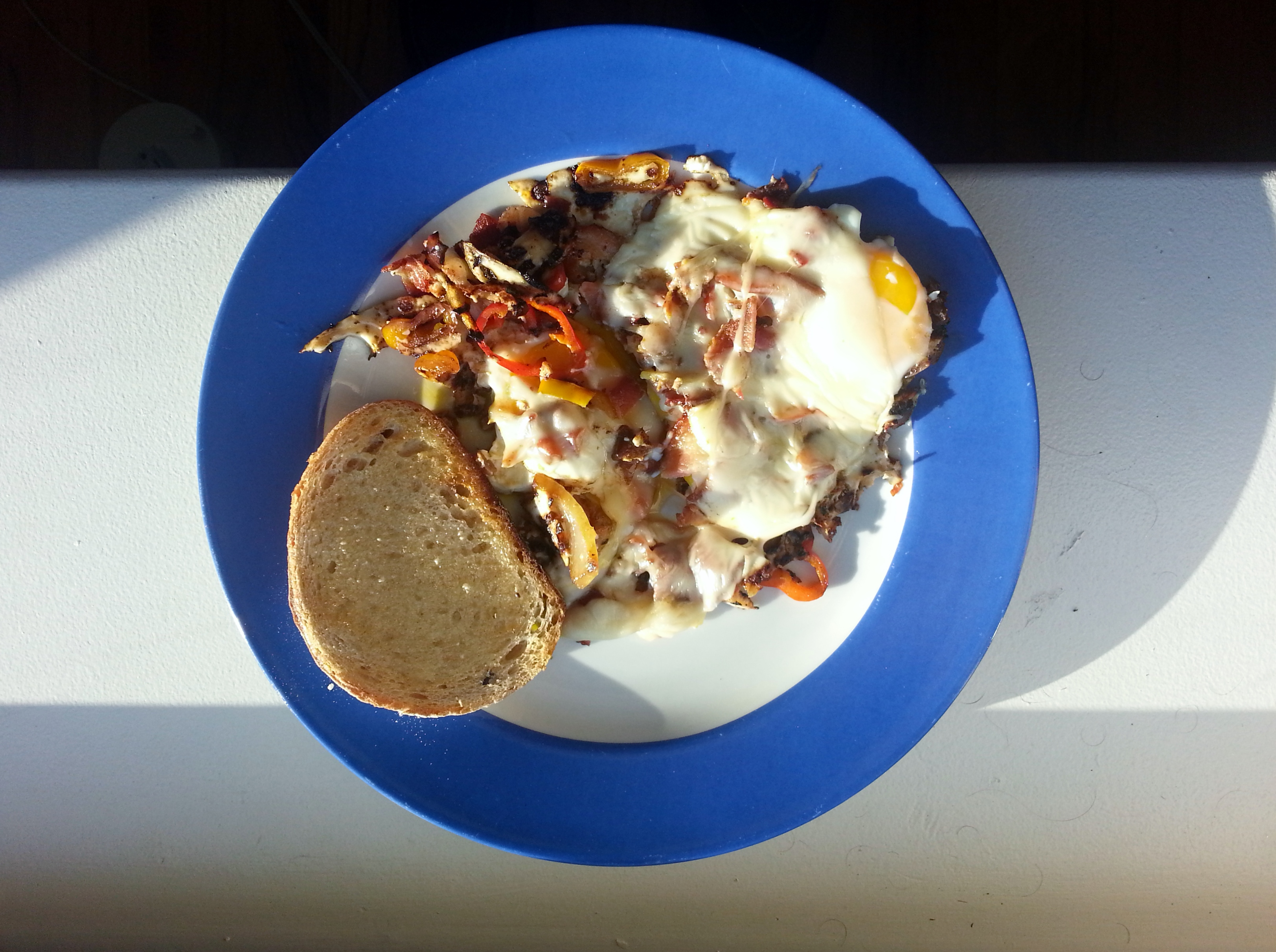 Eggs with Bacon, Onion, and Cheese, via Make It Like a Man!