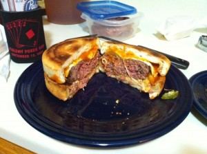 """""""Hamburger Sandwiched between Two Personal Pizzas,"""" from Memphis Meat Club, via Make It Like a Man! Bacon Wrapped Meat Roll"""